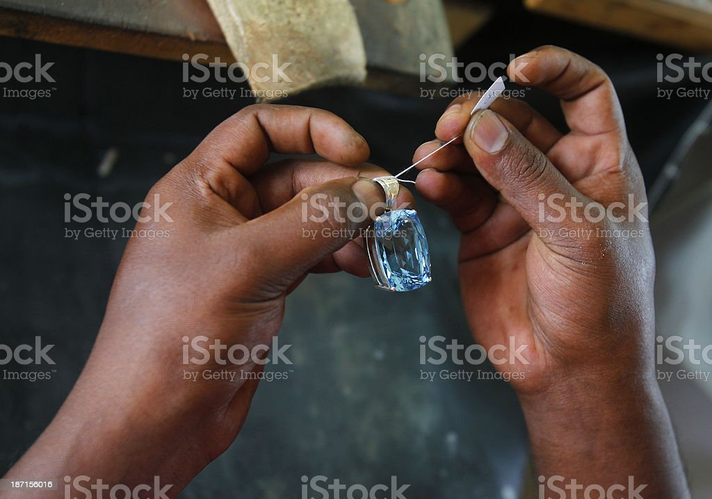 Sri Lankan store worker prepares a gem stock photo