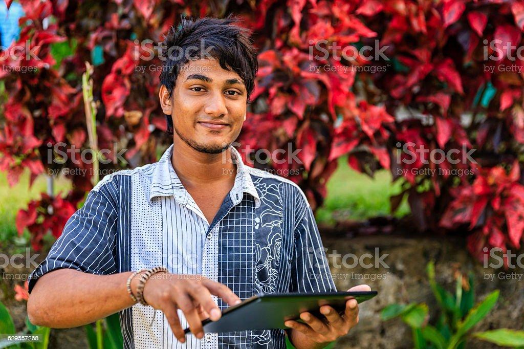 Sri Lankan teenager using a digital tablet stock photo