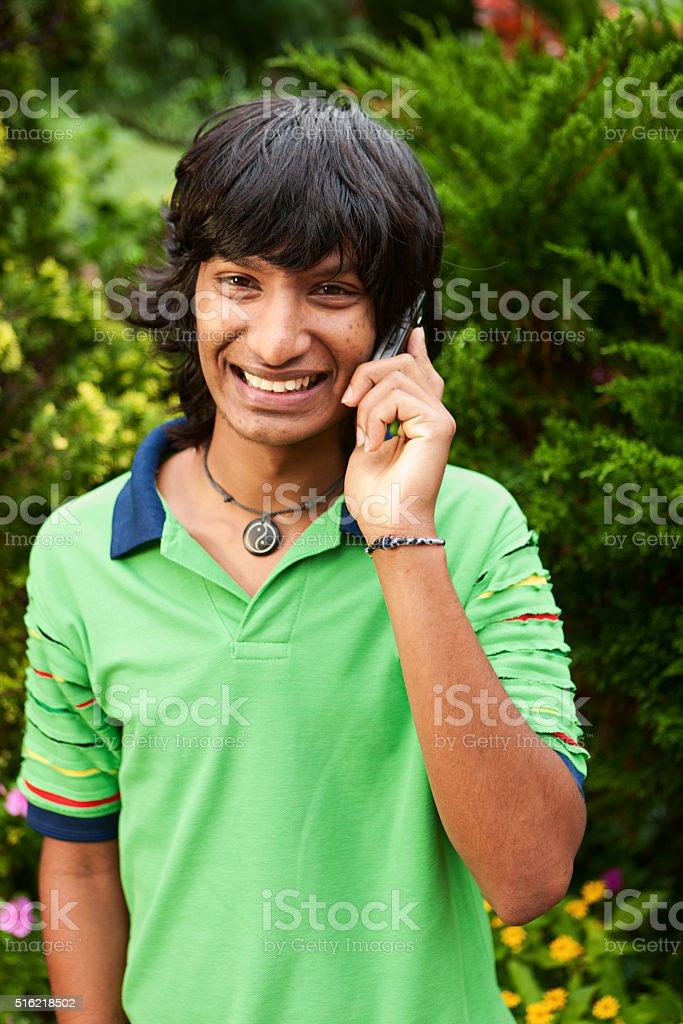 Sri Lankan teenager using mobile phone near Kandy stock photo