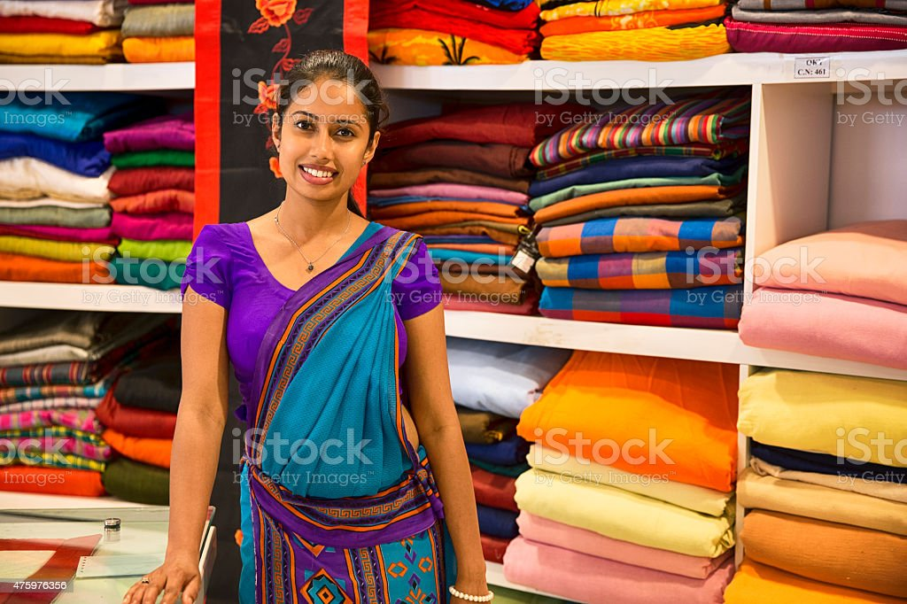 Sri Lankan woman in a Sari as a shop assistant stock photo