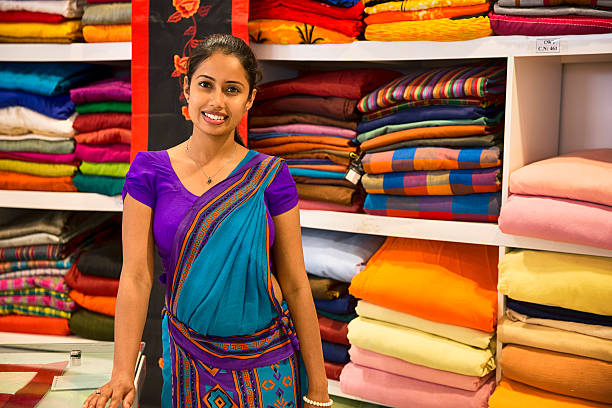 Sri Lankan woman in a Sari as a shop assistant stock photo