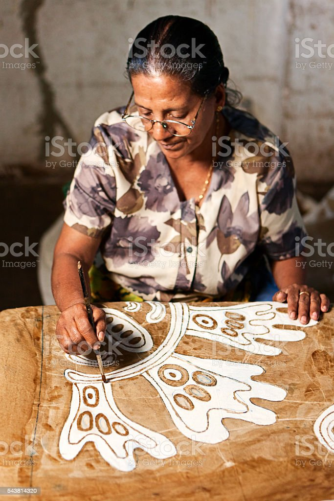 Sri Lankan woman making batik near Kandy stock photo