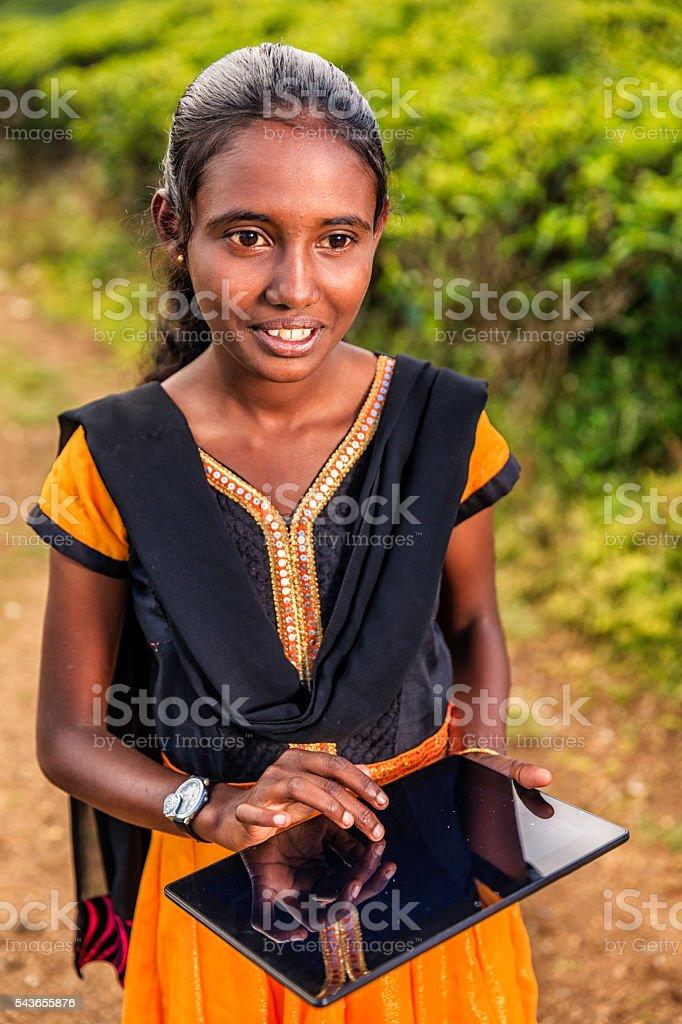 Sri Lankan young girl using a digital tablet, Nuwara Eliya stock photo