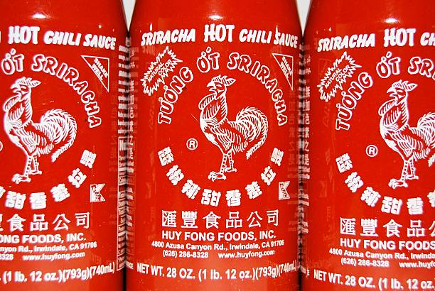 Sriracha Hagerstown, MD, USA - April 26, 2014: Image of Sriracha Hot Chili Sauce. Sriracha is the most popular hot sauce made by Huy Fong Foods, Inc.  sriracha tiger zoo stock pictures, royalty-free photos & images