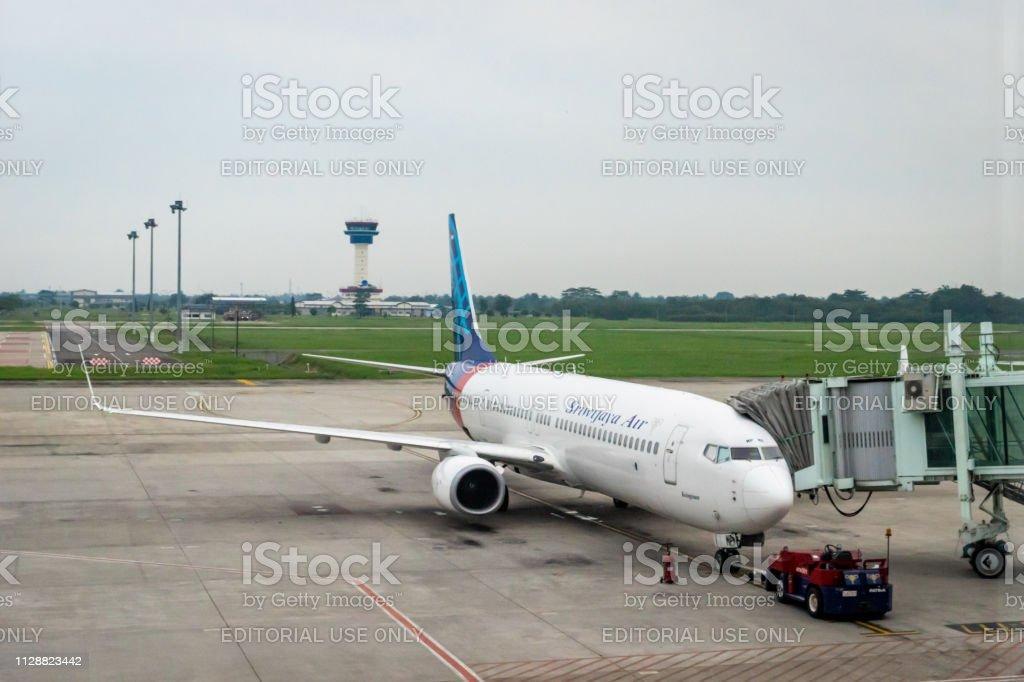 Sriwijaya Air aircraft on runway of Kualanamu Medan airport, Medan, Indonesia. Medan, Indonesia - January 2019: Sriwijaya Air aircraft on runway of Kualanamu Medan airport, Medan, Indonesia. Sriwijaya Air is an Indonesian airline based in Jakarta. Achievement Stock Photo