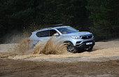 SsangYong Rexton G on the sand