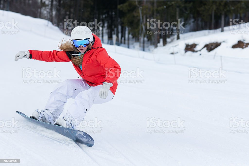 Ssnowboarder on slopes in the sunny morning stock photo