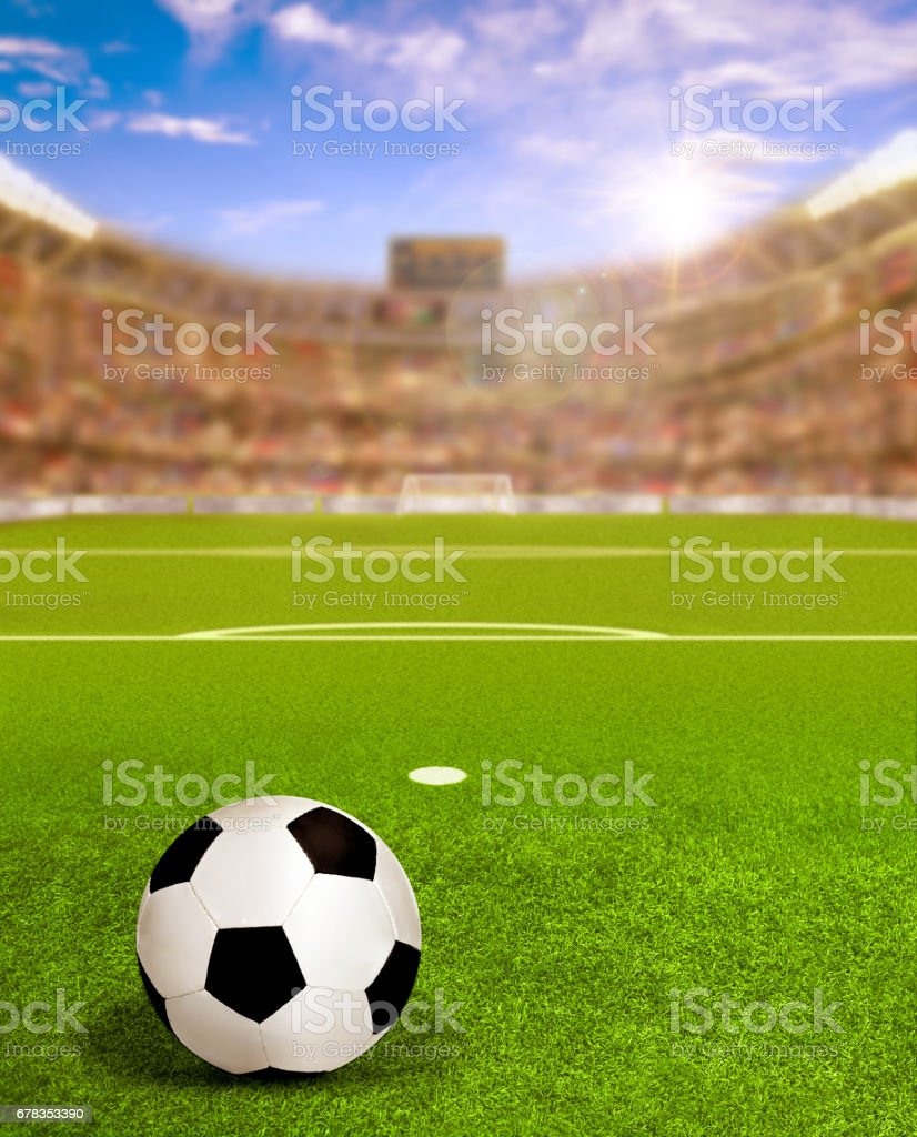 SSoccer Arena With Sun Flare and Ball on Field stock photo