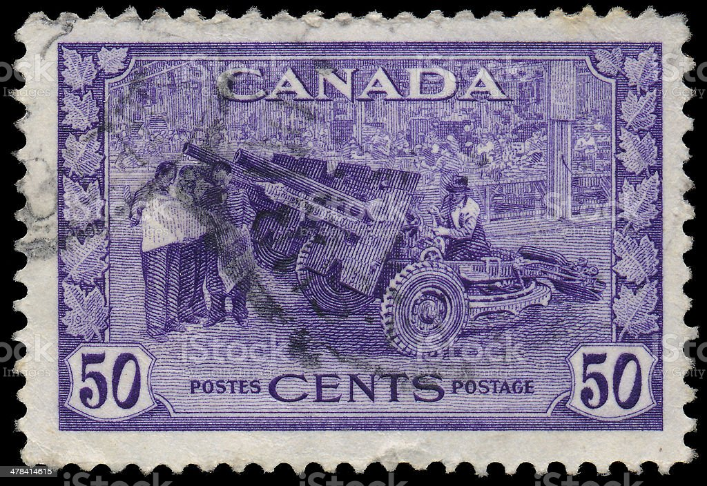 Sstamp printed in the Canada shows Cannon, Munitions Factory stock photo