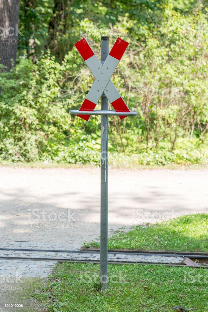 St. Andrew's cross indicating narrow gauge railway in the Great Garden of Dresden stock photo