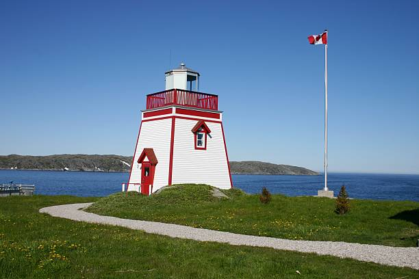 St. Anthony Lighthouse, Newfoundland. St Anthony Lighthouse at Fishing Point Park at the entrance to the St Anthony Harbour, St Anthony, Newfoundland, Canada. st. anthony of padua stock pictures, royalty-free photos & images