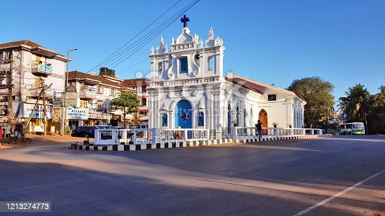 Goa, India – March 12, 2020: St. Anthony's Chapel is located at the center of a circle in the Calangute area in Goa. Calangute beach is about one km west of this church.