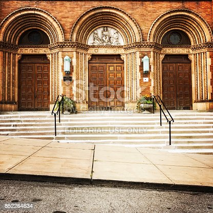 Pittsburgh, USA    September 22, 2017   The entrance to St. Augustine Church in the Lawrenceville section of the city.   St. Augustine is Roman Catholic.  iPhone
