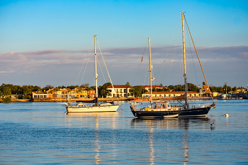 St. Augustine, Florida. January 26 , 2019 . Sailboats and colorful house's on sunset sky background in Florida's Historic Coast .