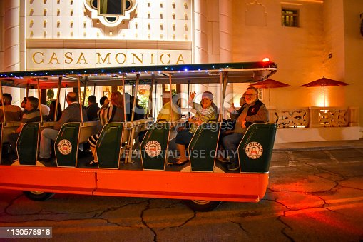 St. Augustine, Florida. January 26 , 2019 . Trolley tour at night on Casa Monica Hotel background in Florida's Historic Coast.