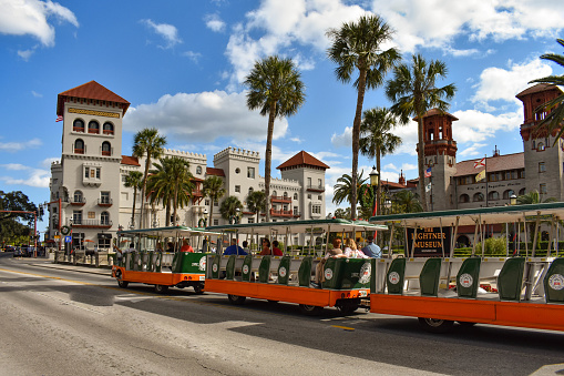 St. Augustine, Florida. January 26 , 2019. Trolley Tour, Casa Monica Hotel and Lightner Museum on lightblue cloudy sky background  at Old Town in Florida's Historic Coast (2)
