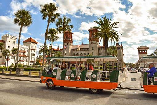 St. Augustine, Florida. January 26 , 2019. Trolley Tour, Casa Monica Hotel and Lightner Museum on lightblue cloudy sky background  at Old Town in Florida's Historic Coast (1)