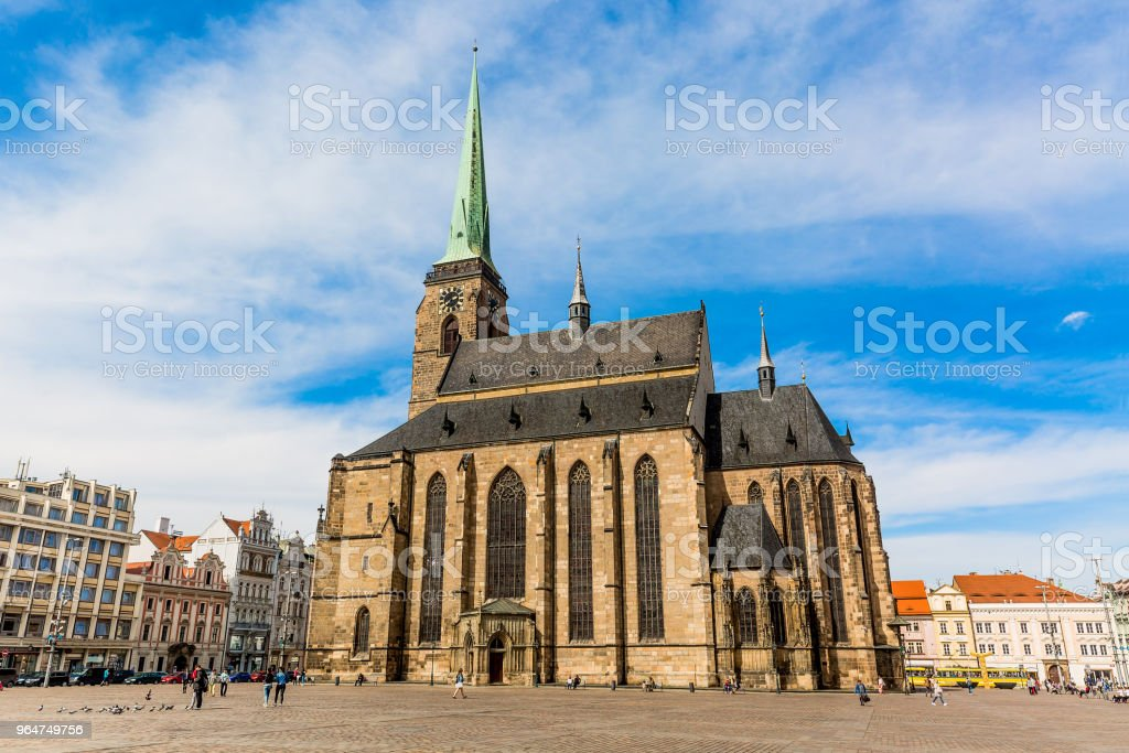 St. Bartholomew's Cathedral in the main square of Plzen with blue sky and clouds in sunny day. Czech Republic, Pilsen. Famous landmark in Czech Republic, Bohemia. royalty-free stock photo