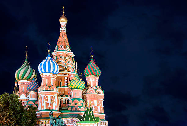 St. Basil Cathedral, Moscow, Russia St. Basil church is a Russian Orthodox cathedral on the Red Square in Moscow. St. Basil's marks the geometric center of Moscow. It has been the hub of the city's growth since the 14th century. kremlin stock pictures, royalty-free photos & images