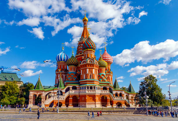 St Basil's Cathedral and Moscow Kremlin Moscow, Russia - September 13, 2018: St Basil's Cathedral and Moscow Kremlin, Russia. This place is the main tourist attraction of Moscow. kremlin stock pictures, royalty-free photos & images