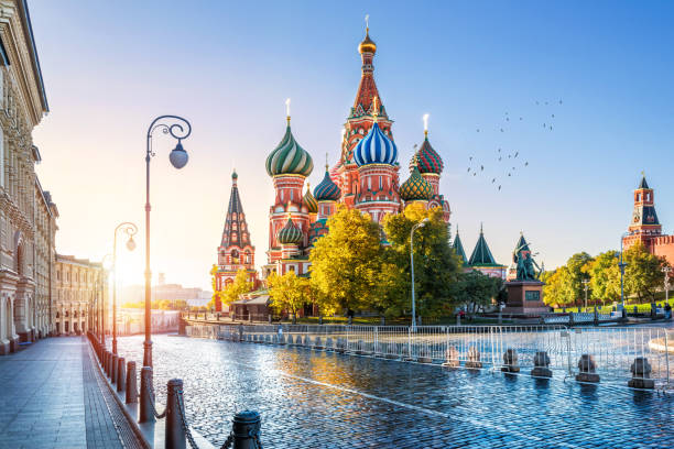 St. Basil's Cathedral and the morning sun St. Basil's Cathedral on Red Square in Moscow and the morning autumn sun moscow russia stock pictures, royalty-free photos & images