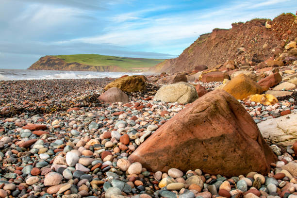 St. Bees beach, Cumbria The stony beach at St. Bees head in Cumbria. Coastal erosion has played its part in shaping the landscape. Shot just before Christmas, 2018. cumbria stock pictures, royalty-free photos & images