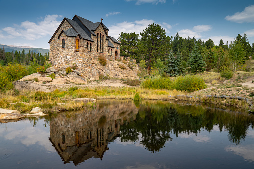 St Catherines Chapel on the Rock Church in the Rocky Mountains of Colorado, reflection in lake