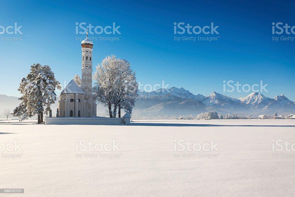 St. Coloman at a sunny winter day, Allgäu, Germany stock photo