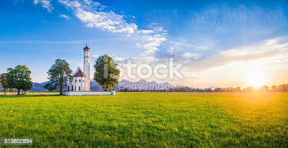 Panoramic view of famous St. Coloman church near Fussen in beautiful evening light at sunset in summer, Schwangau, Bavaria, Germany.