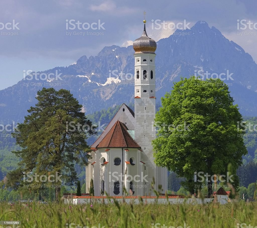 St Colomann and meadow stock photo