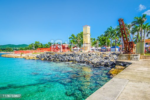 Frederiksted cruise port with old Fort Frederik and clock tower at the waterfront.