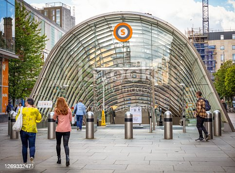 Glasgow, Scotland - People outside the entrance to the St. Enoch Subway station at the base of Buchanan Street in Glasgow's city centre.