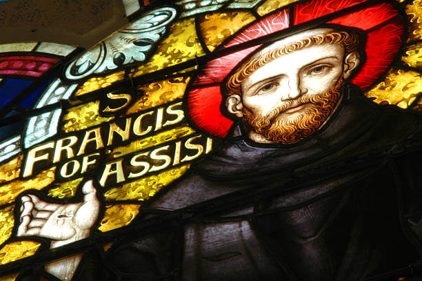 St. Francis of Assisi This is a photo of a stained glass portrait of St. Francis. religious saint stock pictures, royalty-free photos & images