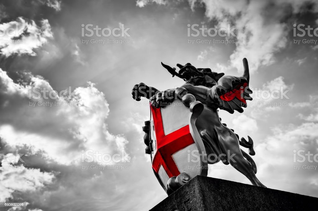 St George dragon statue in London, the UK. Black and white, red flag, shield. stock photo