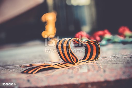 146869841 istock photo St. George ribbon in honor of Victory Day 1945 926939814