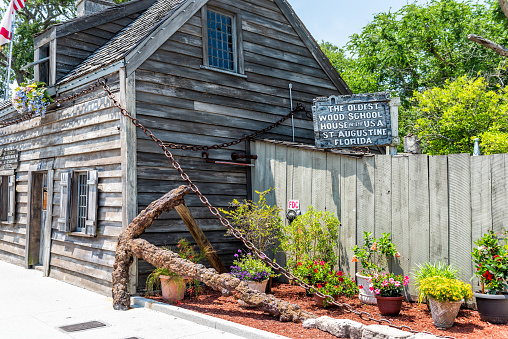 St. Augustine, USA - May 10, 2018: St George Street day in downtown old town Florida city with oldset wood school house