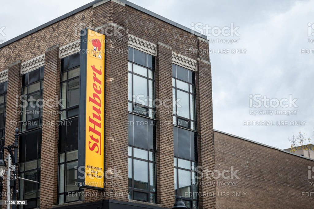 St Hubert logo, in front of their local restaurant in Montreal, Quebec. stock photo