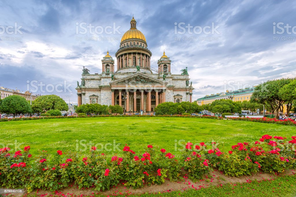 St. Isaac's Cathedral in cloudy weather with flowers stock photo