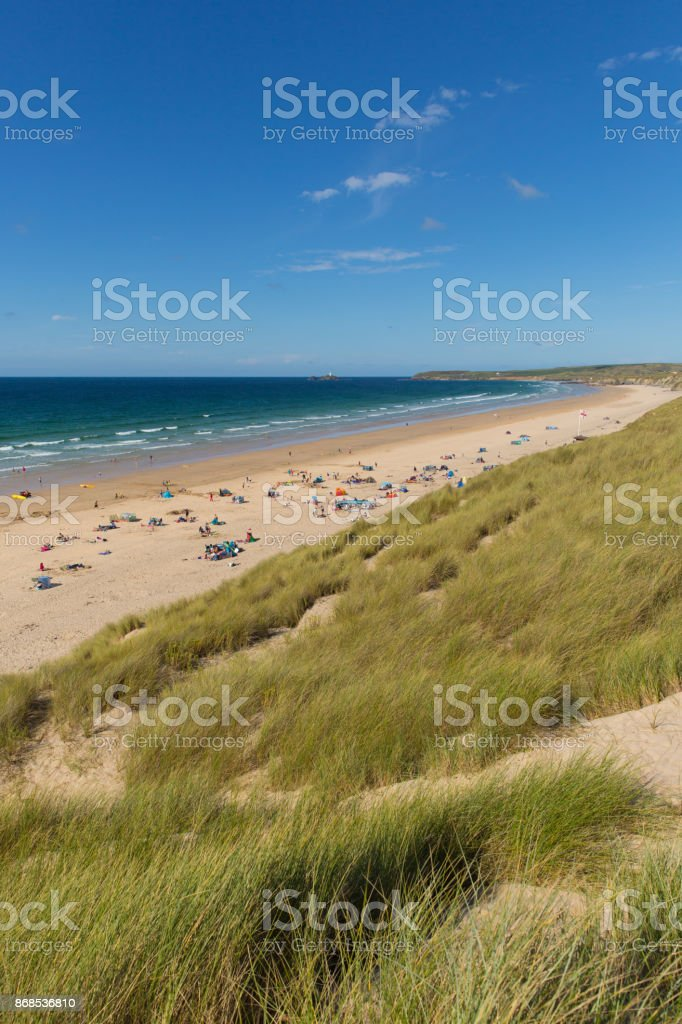 St Ives Bay beach Cornwall uk in summer with people blue sky and sea stock photo
