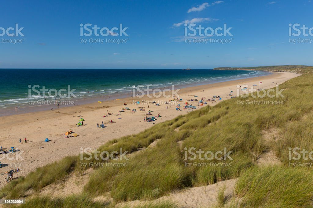 St Ives Bay beach Cornwall uk in summer with people view towards Godrevy lighthouse panoramic view stock photo