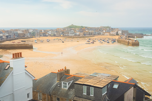 Scenic harbour view from the Malakoff of the quaint and charming seaside Cornish port town of St Ives at low tide on the Atlantic coast of Cornwall, England, UK.