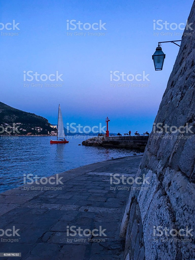 St John Fortress of Dubrovnik, Croatia, with sailboat and lighthouse ストックフォト