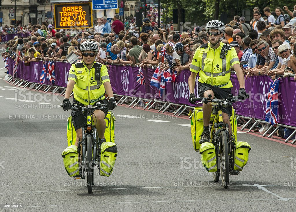 St John's Ambulance medics on cycles stock photo