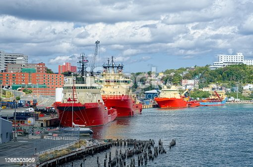 Cumulus clouds loom over St John's Newfoundland on a crystal clear September day with cable laying ships and private boats at anchor