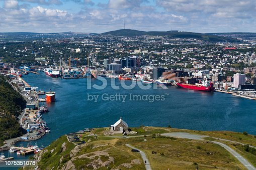 A cityscape view of St. John's harbor and city taken from Signal hill park in Newfoundland Canada.