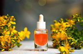 St. John's wort herbal oil tincture in a small bottle closeup