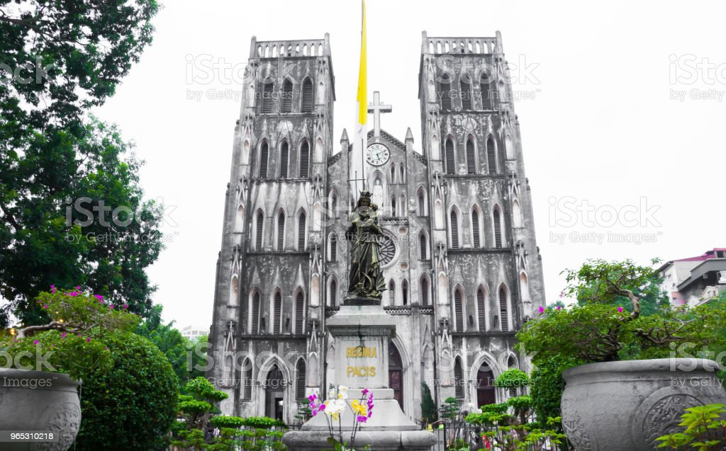 St. Joseph's Cathedral and Regina Pacis (Queen of Peace) Statue in front, Hanoi, Vietnam. St. Joseph's Cathedral is a Neogothic style church that serves as the cathedral of the Roman Catholic zbiór zdjęć royalty-free