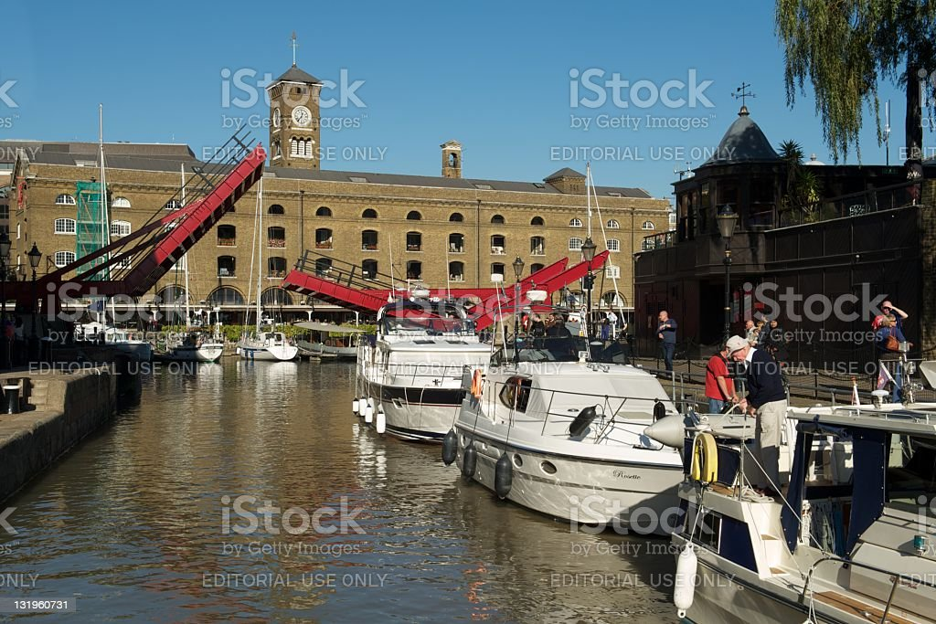 St Katherine Docks with boats and open drawbridge, London stock photo
