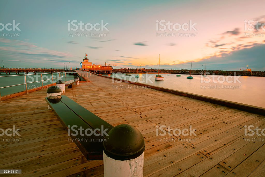 St. Kilda Pier at Dusk with boats in the harbour stock photo