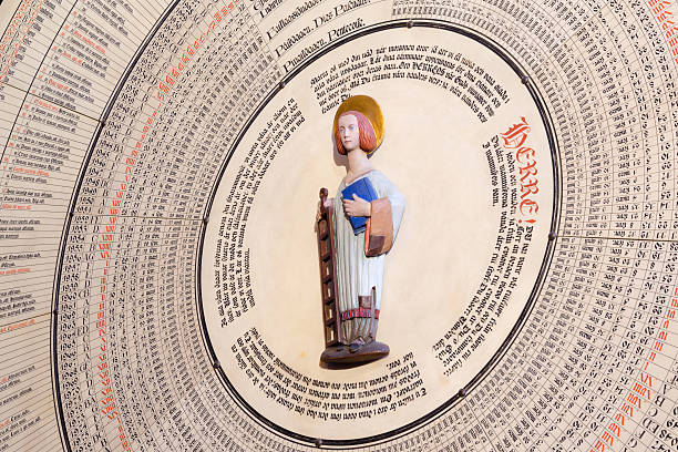 st. lawrence on the calendar in lund cathedral - lund stock photos and pictures